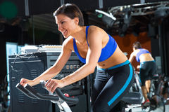 Aerobics spinning monitor trainer woman at gym. At trainning class Royalty Free Stock Image
