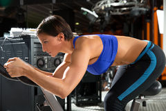 Aerobics spinning monitor trainer woman at gym Royalty Free Stock Images
