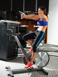 Aerobics spinning monitor trainer woman stretching Royalty Free Stock Photos