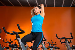 Aerobics spinning woman stretching exercises after workout Royalty Free Stock Photography
