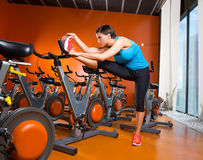 Aerobics spinning woman stretching exercises after workout. At gym Stock Image