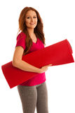 Aerobics - woman with mat ready to work out isolated over white Royalty Free Stock Photography