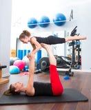 Aerobics woman personal trainer of children. Aerobics women personal trainer of children girl stability balance stock photography