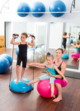 Aerobics woman personal trainer of children girl. Aerobics women personal trainer of children girl with stability ball stock photography