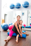 Aerobics woman personal trainer of children girl Stock Photos