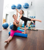 Aerobics woman personal trainer of children girl. Aerobics women personal trainer of children girl stability with foam roller royalty free stock image