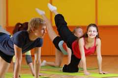 Aerobics woman smiles. Young woman smiles while makink aerobics exercise in group stock photos
