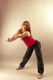 Aerobics zumba fitness woman. Beautiful Young Woman In Zumba Dancing Pose Banding Over Royalty Free Stock Image