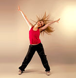 Aerobics zumba fitness woman. Young woman dancing fitness with disheveled hair and raised hands in studio Stock Photography