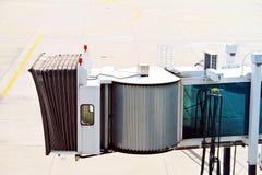 Aerobridge in plane parked Stock Photos