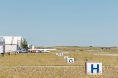 Aerodrome of Casarrubios del Monte, Toledo, Spain. Partial view of the facilities of an aerodrome, we can see some airplanes circulating royalty free stock photography