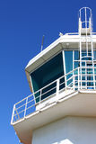 Aerodrome control tower with ladder. Part of aerodrome control tower with ladder, against clear sky Stock Photo