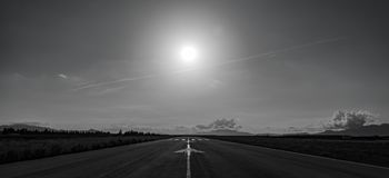 Aerodrome runway back light with mountains in the background. Panorama of aerodrome runway back light with mountains in the background stock photos