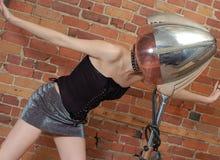 Aerodynamic position. Sexy woman & vintage hair dryer Royalty Free Stock Photos