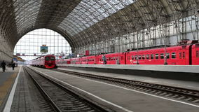 Aeroexpress red Train on Kiyevskaya railway station  (Kiyevsky railway terminal,  Kievskiy vokzal). Is one of the nine main railway stations of Moscow stock footage