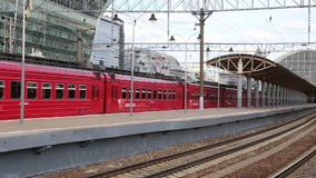 Aeroexpress red Train on Kiyevskaya railway station  (Kiyevsky railway terminal,  Kievskiy vokzal). Is one of the nine main railway stations of Moscow stock video footage