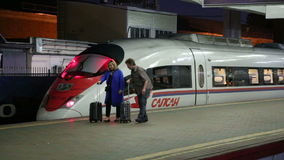 Aeroexpress Train Sapsan and passengers at the Leningradsky railway station (night). Moscow, Russia. High-speed train acquired OAO Russian Railways for use stock video footage
