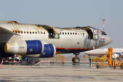 Aeroflot Ilyushin IL-96-300 caught fire while standing at Sheremetyevo international airport. SHEREMETYEVO, MOSCOW REGION, RUSSIA - JUNE 3, 2014: Aeroflot Royalty Free Stock Photos
