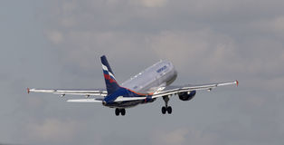 Aeroflot - Russian Airlines Airbus A319-111 aircraft on the cloudy sky background Stock Images