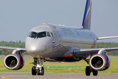 Aeroflot Sukhoi Superjet-100 RA-89024 landing at Sheremetyevo international airport. SHEREMETYEVO, MOSCOW REGION, RUSSIA - JULY 1, 2015: Aeroflot Sukhoi Stock Photo