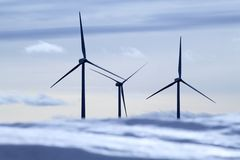 Aerogenerator electric windmills snow mountain Stock Photo