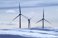 Aerogenerator electric windmills snow mountain Stock Photo