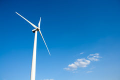 Aerogenerator windmill in blue sky Royalty Free Stock Images