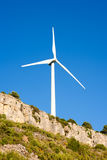 Aerogenerator windmill in rocky mountain Stock Image