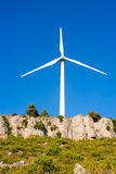 Aerogenerator windmill in rocky mountain Royalty Free Stock Images