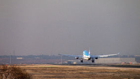 Aerolineas Argentinas jet airliner approach to land at Madrid airport runway, seen from behind Stock Images