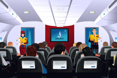 Aeromoço que mostra o procedimento de segurança aos passageiros ilustração royalty free