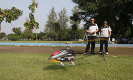 Aeromodelling. Devotee prepares to fly his helicopter in the city of Solo, Central Java, Indonesia stock images