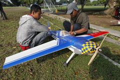 Aeromodelling. Devotee prepares to fly his plane in the city of Solo, Central Java, Indonesia royalty free stock image