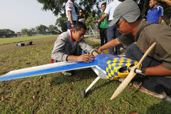 Aeromodelling. Devotee prepares to fly his plane in the city of Solo, Central Java, Indonesia royalty free stock photo