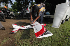 Aeromodelling. Devotee prepares to fly his plane in the city of Solo, Central Java, Indonesia stock image