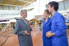Aeronautical engineers students and teacher stock image