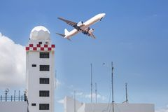 Free Aeronautical Meteorological Station Tower Or Weather Radar Dome Station Tower In Airport With Passenger Airplane Jet Taking Off Royalty Free Stock Image - 104037296