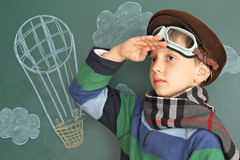Aeronautics. Boy dreaming of the sky Stock Image