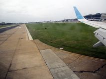 Aeroparque Jorge Newbery Buenos Aires Argentina Southamerica. Wing of the plane Landing track stock photo