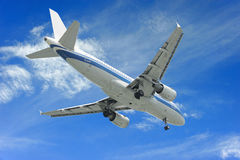 Aeroplane. On blue sky background royalty free stock photography