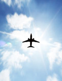 Aeroplane. On blue and cloudy sky royalty free stock images