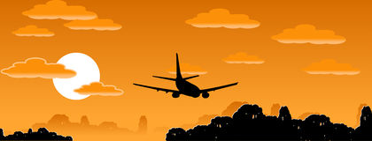 Aeroplane. Silhouette on the evening sky background Royalty Free Stock Image
