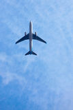 Aeroplane. Shot from straight under on blue sky Stock Images