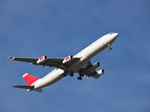 Aeroplane. Landing on the airport stock image