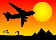 Aeroplane above pyramids Royalty Free Stock Photo