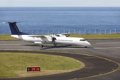 Aeroplane on the airport runaway near the ocean just arrived Stock Image