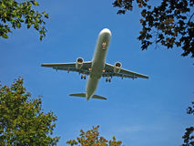 Aeroplane on approach. Aeroplane landing at the Düsseldorf airport in Germany Stock Image