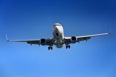 Aeroplane approaching airport Stock Photography