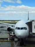 Aeroplane at arrival terminal aerobridge Stock Photo