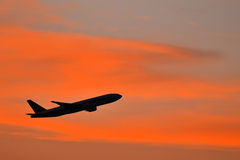 Aeroplane with beautiful sunset Stock Photo